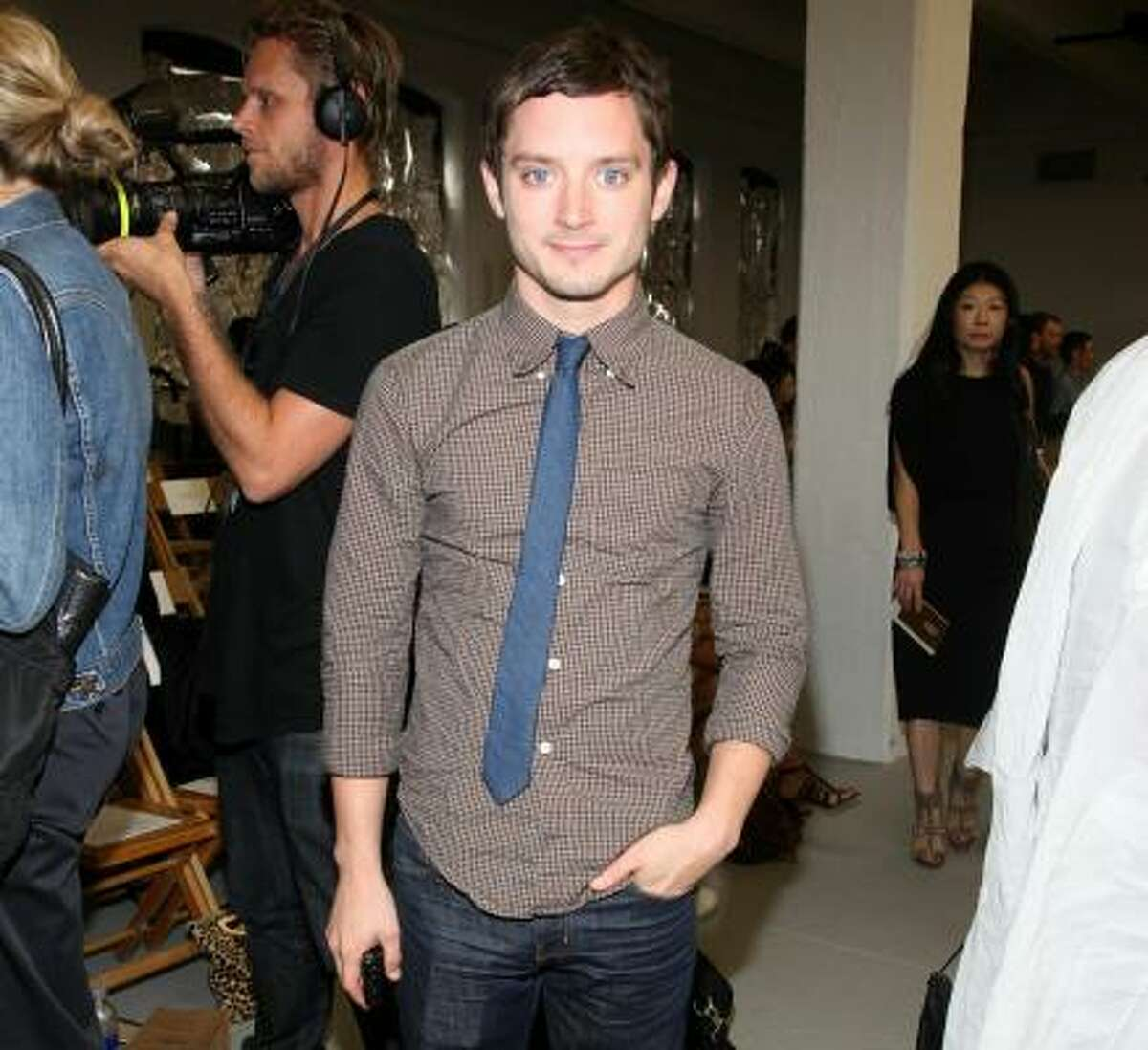 Actor Elijah Wood definitely looks more chic than hobbit behind the stage of the Rodarte show.