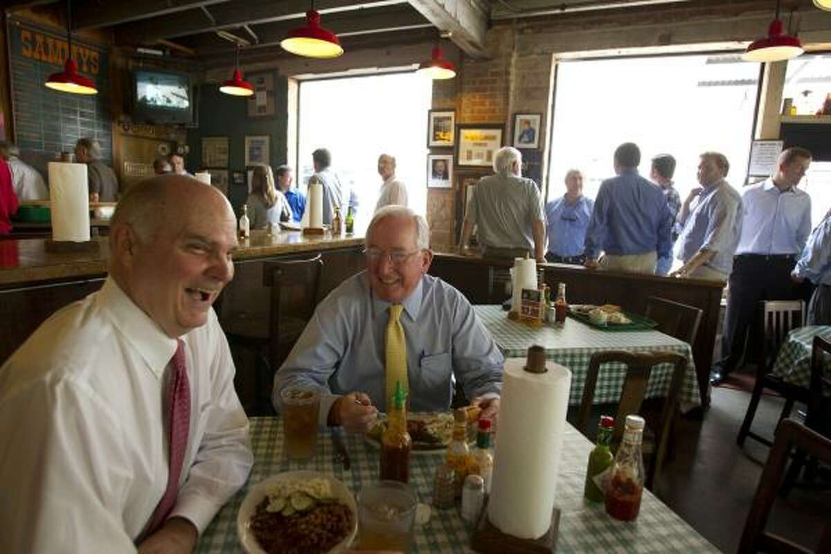 Financial advisors Jim Marsh, 65, and Tom Donovan, 65, share a laugh at Sammy's Bar-B-Q, a hot spot for business men and women in downtown Dallas. Donovan, a conservative, believes the influx of people moving to the Dallas area from out of state has giving the democratic party a boost.