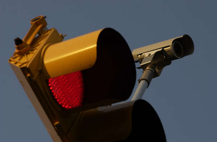 The city's 70 red light cameras, like this one at the Southwest Freeway and Bellaire, raise an average of nearly $630,000 a year each for a total of about $44 million. Photo: Ben DeSoto, Houston Chronicle