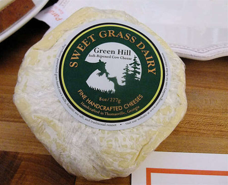 Sweet Grass Dairy's Green Hill cheese, made in the style of Camembert, at a Houston Dairymaids public tasting.  This Georgia cow's milk cheese won a top prize at the 2010 convention of the American Cheese Society. Photo: Alison Cook, Chronicle
