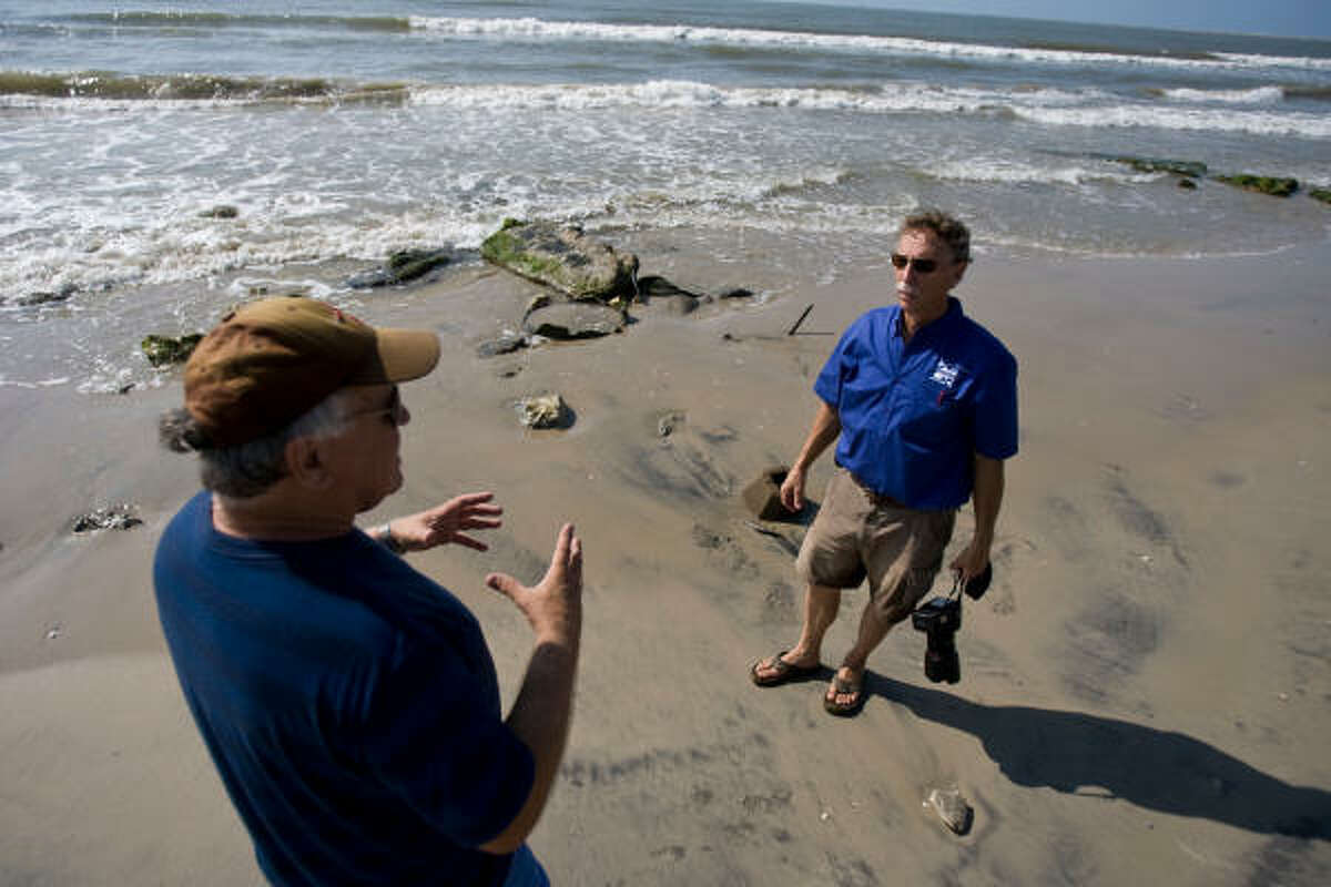 Billy Proske, left, and Ellis Pickett, chairman of the Surfside Foundation, talk about the problems with the beach and their frustrations in getting the authorities to fix it in 2009.