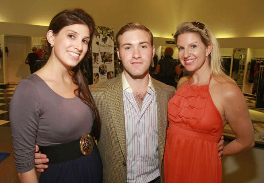 "Camille Charvet, from left, Dustin Palmer and Lori Freese at ""An Evening in Tuscany,"" a shopping party at Tootsies celebrating luxury retailer Romana Correale. Ten percent of proceeds benefited the American Heart Association. Photo: Gary Fountain, For The Chronicle"