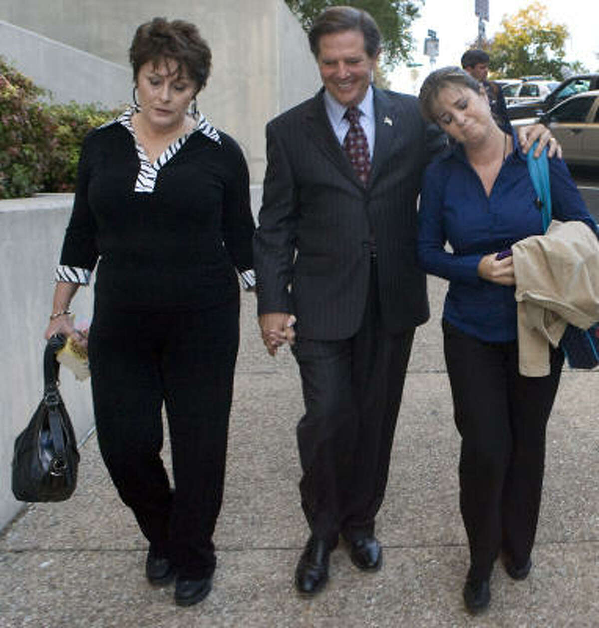 Tom Delay, his wife, Christine, and daughter Danielle Garcia leave the courthouse after Wednesday's verdict.
