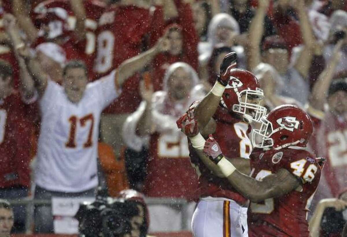 Sept. 13: Chiefs 21, Chargers 14 Chiefs tight end Tony Moeaki, left, and running back Tim Castille celebrate after Moeaki caught a short pass in the end zone for a touchdown.