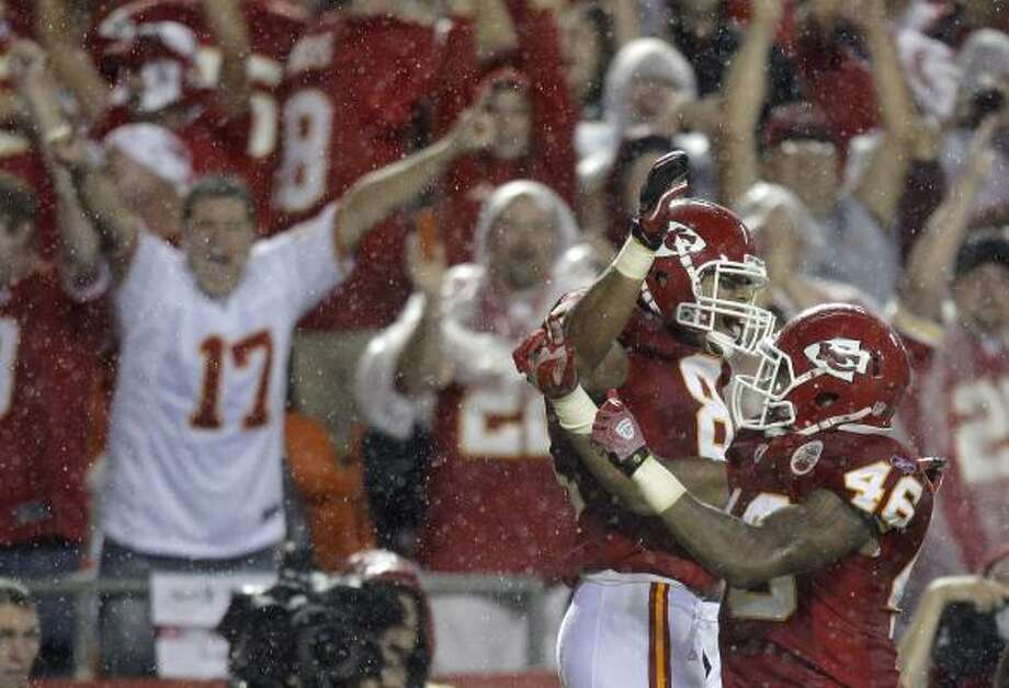 Sept. 13: Chiefs 21, Chargers 14Chiefs tight end Tony Moeaki, left, and running back Tim Castille celebrate after Moeaki caught a short pass in the end zone for a touchdown. Photo: Charlie Riedel, AP