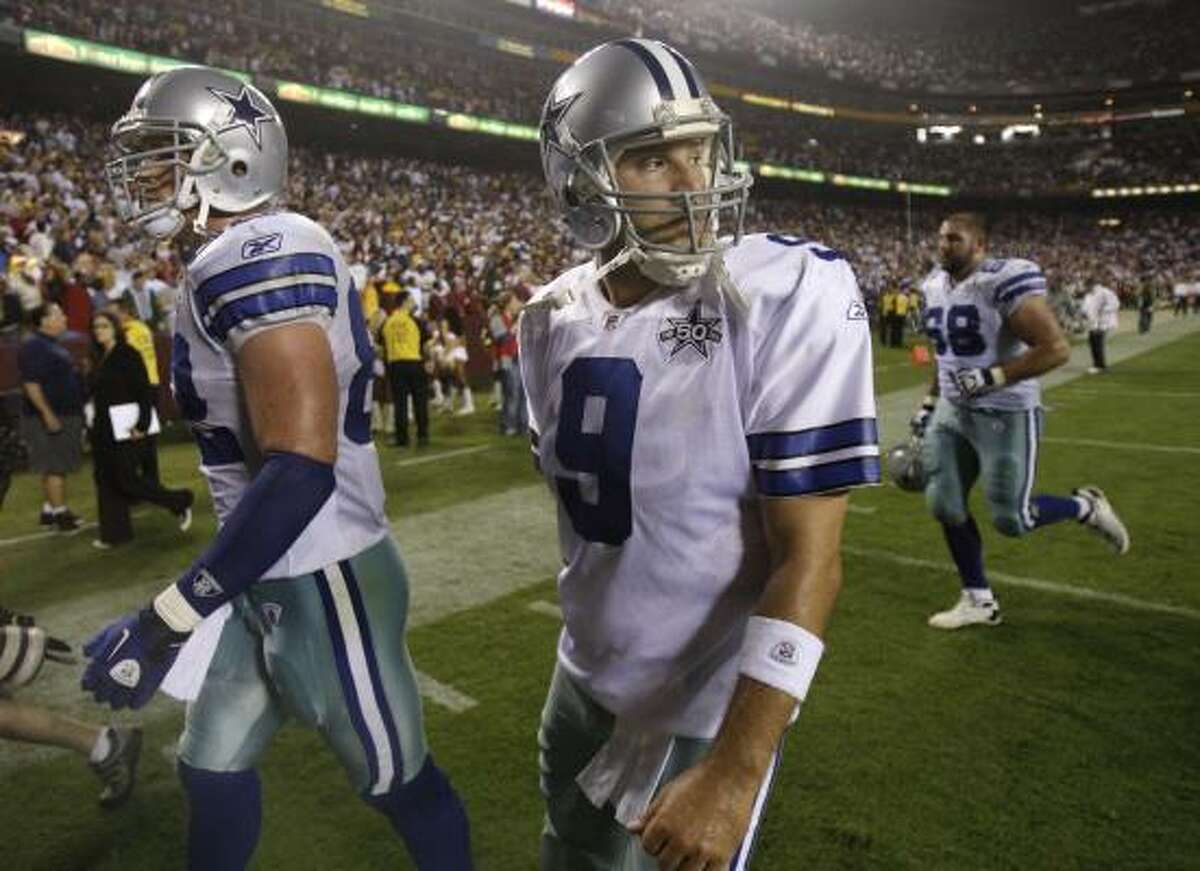 Sept. 12: Redskins 13, Cowboys 7 Cowboys quarterback Tony Romo (9) walks off the field with teammates Jason Witten, left, and Doug Free after losing to the Redskins on Sunday night.