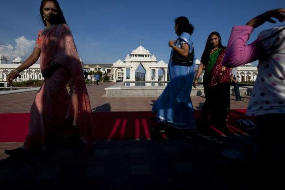 A group of Hindu women prepare to worship at the BAPS Shri Swaminarayan Mandir in Stafford. The BAPS are a part of the growing Asian population in Fort Bend County that is not only changing the demographics of the county but also its politics. Photo: Johnny Hanson, Houston Chronicle