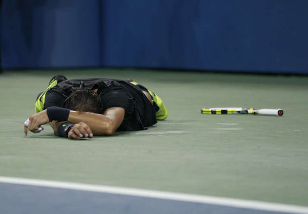 Sept. 13 Rafael Nadal, of Spain, falls to the ground in celebration after defeating Novak Djokovic, of Serbia, and winning the men's championship match at the U.S. Open tennis tournament in New York.