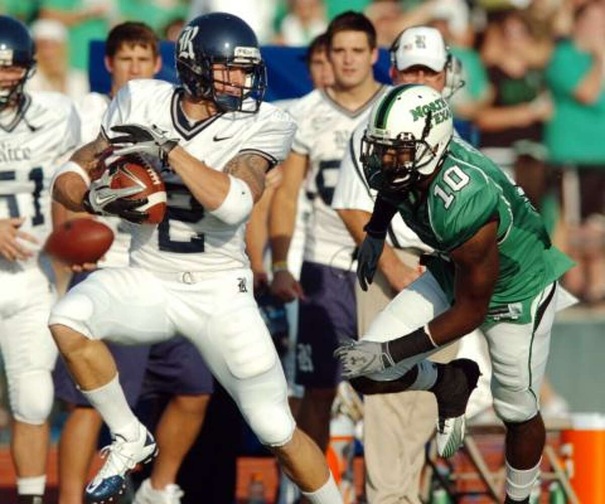 Rice running back Sam McGuffie (2) slips out of the reach of North Texas defensive back DaWaylon Cook on his way to a 51-yard touchdown reception on the Owls' first offensive play of the game.