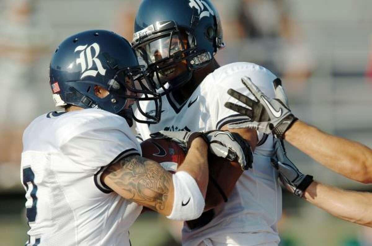Rice's Sam McGuffie, left, celebrates his touchdown with senior wide receiver Patrick Randolph.