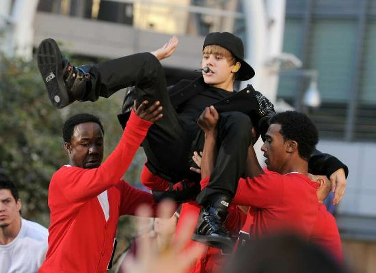 Justin Bieber is carried onstage during the 2010 MTV Video Music Awards.