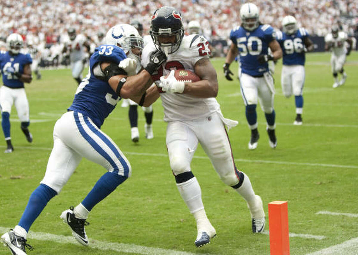 Sept. 12: Texans 34, Colts 24 Texans running back Arian Foster (23) is hit by Colts cornerback Melvin Bullitt (33) as he scores on a 25-yard touchdown run during the fourth quarter. Foster finished the day with a franchise record 231 rushing yards to go with three touchdowns.