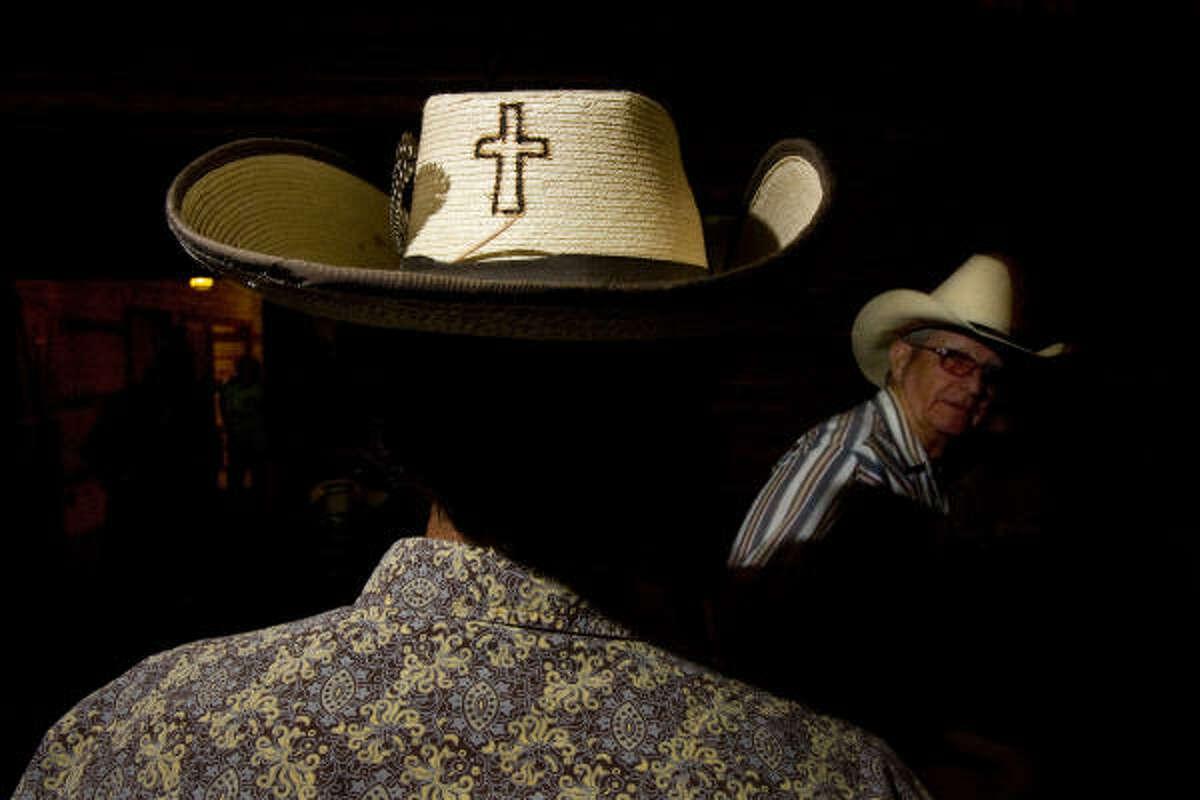 Alex Seeton, 18, shows his faith on his hat at the Bar None Cowboy Church in Rusk County's Tatum.