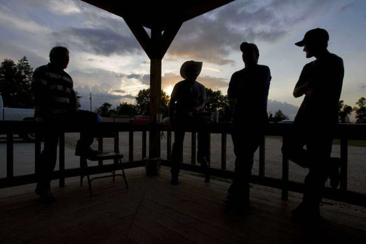 From left, Kenny Schoubroek, 43; Dan Jones, 43; Michael Williams, 37, and his son Mackenzie Williams, 14, sit outside the Bar None Cowboy Church.