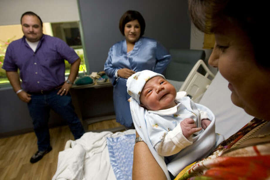One-day-old, Gabrial Alejandro Vela, is held by his gradmother, Alicia Balderas, as his father, Salvador Vela Jr., 34, a pharmacy consultant, and mother, Alexandra Vela, 31, a small business owner, look on as they spend time with Gabrial at Woman's Hospital at Renaissance in McAllen. Woman's Hospital at Renaissance has assisted in delivering more than 23,000 babies since it opened in Oct. 2007. McAllen, the county seat in Hidalgo County, is a rapidly growing city of 130,000 with about 1,500 babies born each month in the greater metropolitan area. The county is young with a median age of 27. Just over 35 percent of the county's 750,000 people are under the age of 18. Photo: Johnny Hanson, Houston Chronicle