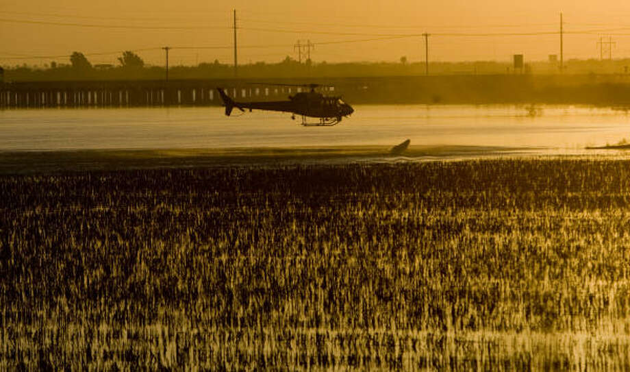 Agents with the U.S. Customs and Border Protection office of Air and Marine, patrol over the Rio Grande River in Hidalgo. Though the interest in promoting trade between the U.S. and Mexican border cities is important, drug trafficking and border protection will be one of the main topics of the gubernatorial election. Photo: Johnny Hanson, Houston Chronicle