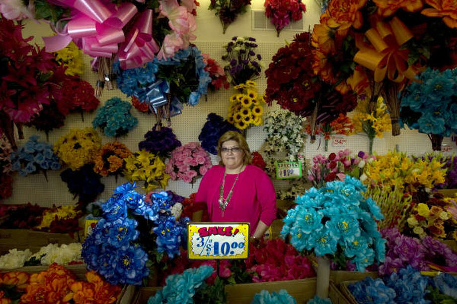 "Portrait of Monica Weisberg-Stewart, owner of Gilberto's, a dollar store in McAllen's downtown. Weisberg-Stewart said she relies heavily on the ""circulatory trade"" between Mexican nationals, who make up a good portion of her business, and U.S. citizens. She said because of visa price increases and delays at the border crossing, her business from Mexican nationals has slowed. Photo: Johnny Hanson, Houston Chronicle"