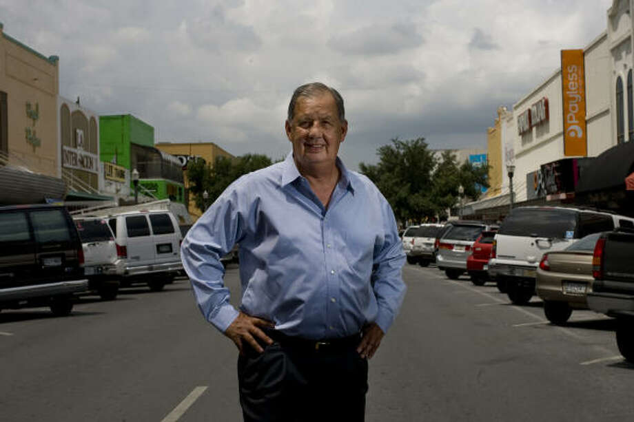 "Portrait of Richard Cortez, 66, mayor of McAllen, in the city's old downtown merchant area where about half of the customers come from Mexico to shop at the local stores. ""Hotels, restaurants, hardware stores, auto-parts, clothing stores, health care food stores - I mean every retailer here is touched by our ties to Mexico,"" Cortez says.   When in Washington D.C., he works to dispel fears about illegal immigration and to educate government officials about the benefits of his region's close ties to Mexico. Photo: Johnny Hanson, Houston Chronicle"