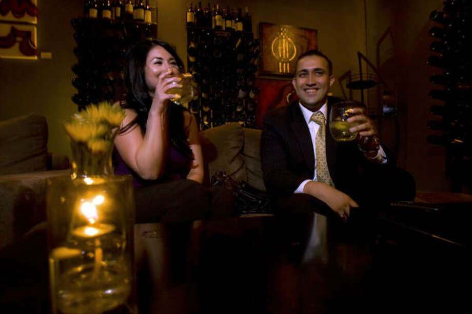 Serina Briseno, 27, a law student and John Jett, 30, a financial advisor, both of McAllen, have drinks at a new contemporary wine bar named house. wine. in McAllen's downtown. Because of the violence in Mexico, they are attempting to bring more nightlife into McAllen, where previously people would go across the Rio Grande River into Mexico to go to clubs, bars and restaurants. McAllen, the county seat in Hidalgo County, is a relatively prosperous and rapidly growing city of 130,000, in one of the poorest counties in the nation. With a median age of 27, the county is made up of a growing number of young people. Just over 35 percent of the county's 750,000 people are under the age of 18. Photo: Johnny Hanson, Houston Chronicle