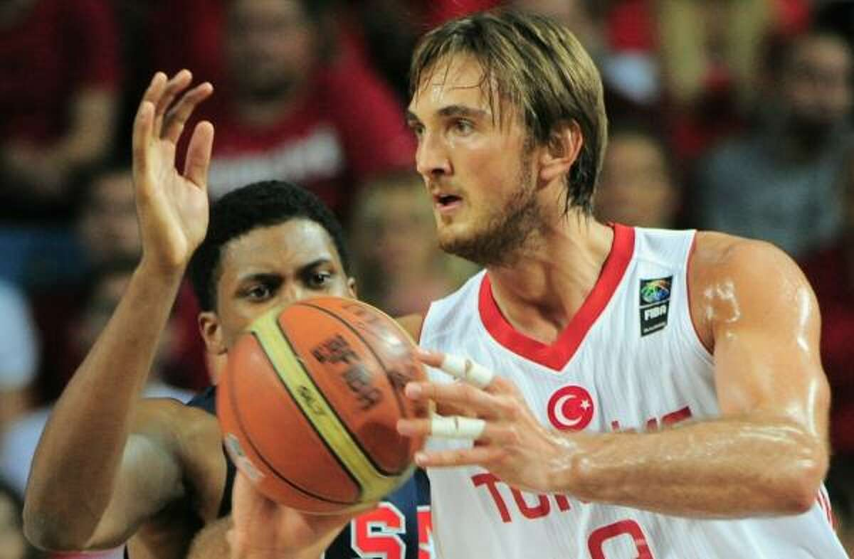 Rudy Gay, left, vies with Turkey's Semih Erden during a basketball World Cup Championship final match.