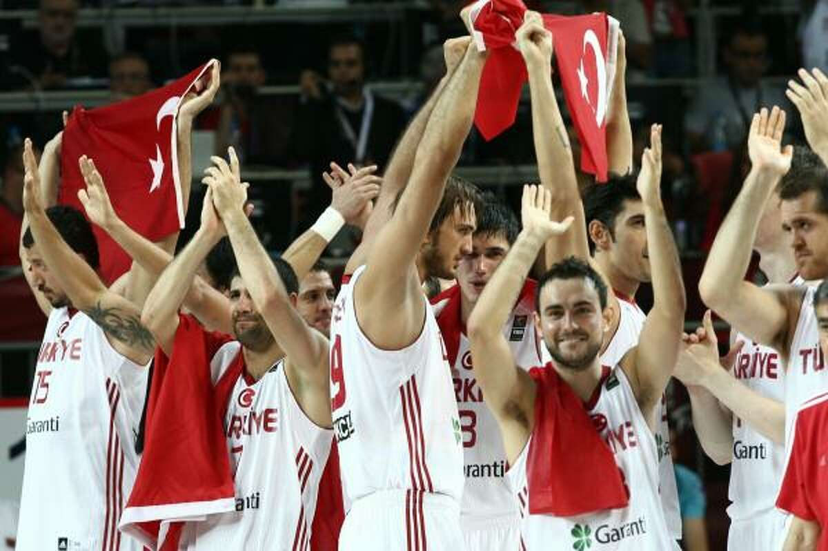 Turkish players celebrate on the podium after the game.