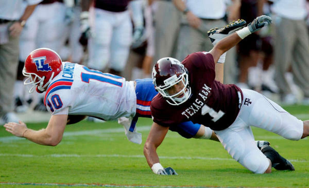 Texas A&M cornerback Trent Hunter (1) drops Louisiana Tech quarterback Colby Cameron in the first quarter.
