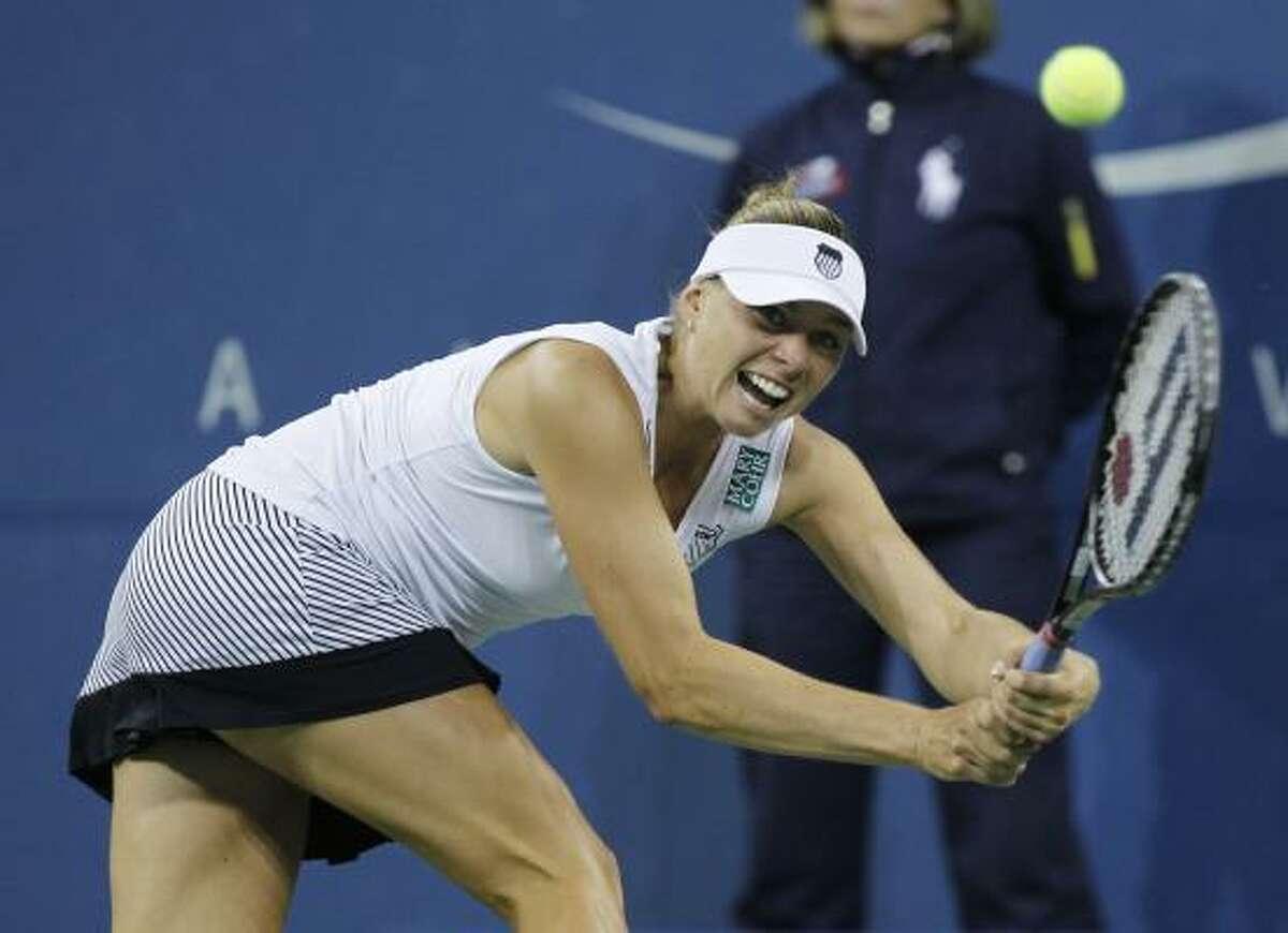 Vera Zvonareva returns the ball to Kim Clijsters.