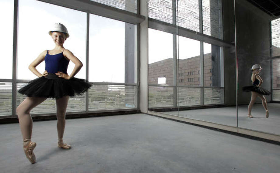 This practice room in the new Houston Ballet building probably isn't a construction danger zone, but Siri Ell, 15, a student with the Ballet's Ben Stevenson Academy, is taking no chances. Photo: Karen Warren, Chronicle