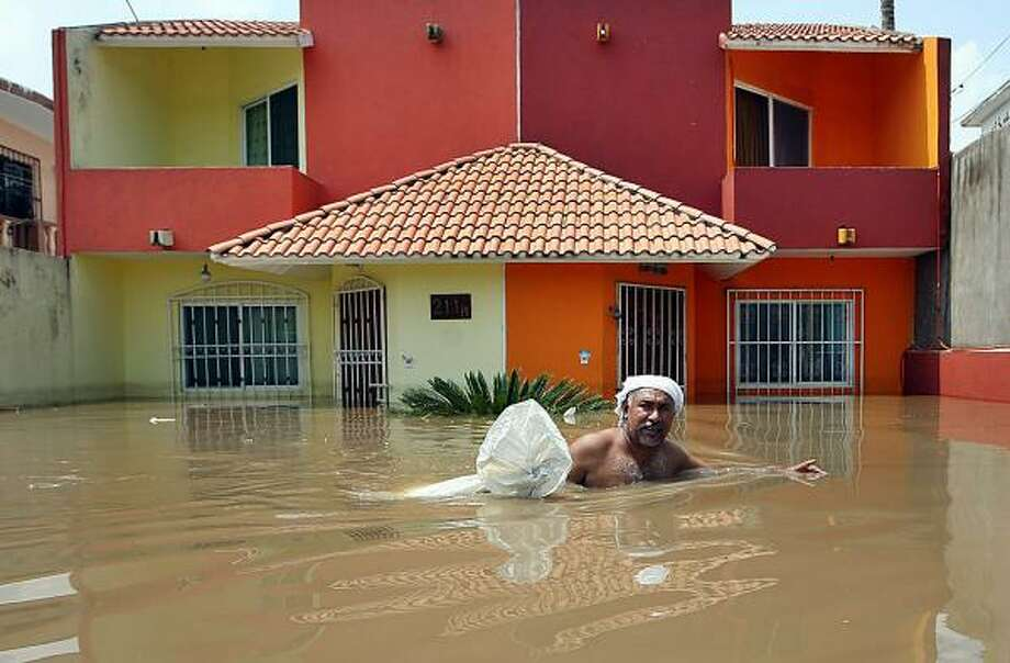 Streets usually filled with traffic are instead filled with floodwaters in Veracruz, Mexico, where more than two dozen weather-related deaths have been recorded since August. Photo: WWW.ELGOLFO.INFO, AFP/Getty Images