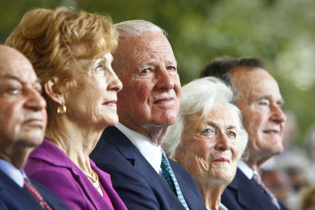 Former President George H.W. Bush, right, and his wife, Barbara, join James A. Baker III, center, and his wife, Susan, at the Baker statue dedication Tuesday. Photo: Michael Paulsen, Houston Chronicle