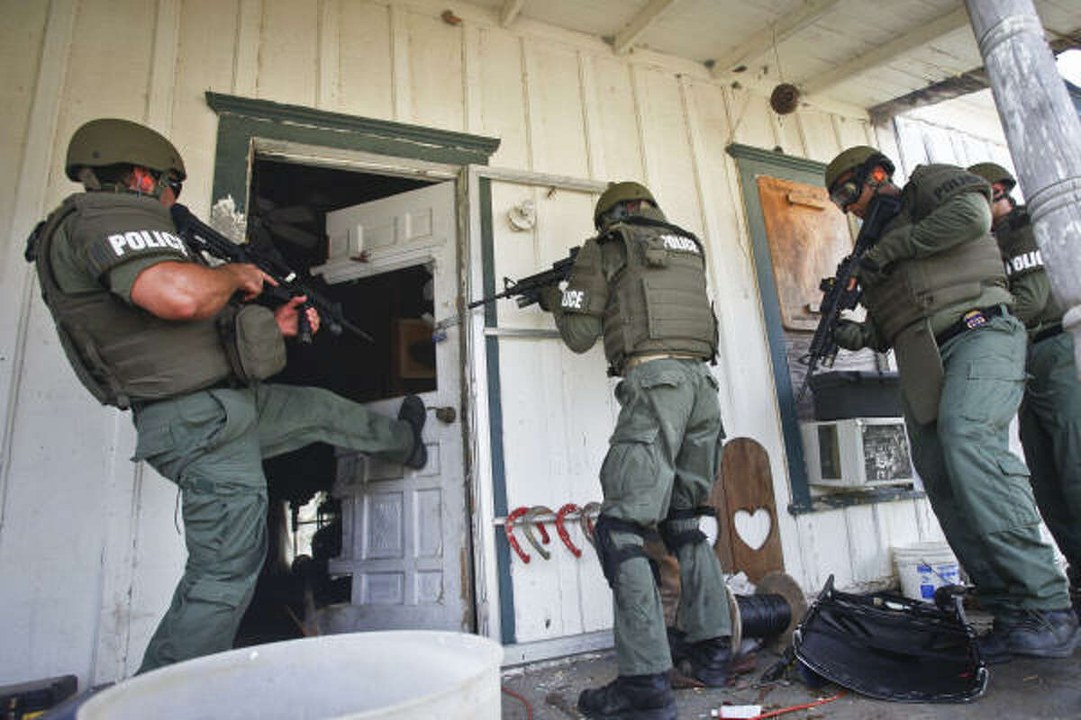 Special Agents from the U.S. Bureau of Alcohol, Tobacco, Firearms and Explosives participate in an explosives breaching exercise as they practice entering a locked home during a training session near San Marcos. Facing increasingly dangerous and better armed bad guys, such as drug cartels, prison gangs and others, the U.S. Bureau of Alcohol, Tobacco, Firearms and Explosives has upped its game for taking on criminals. When a street cops go through a door, they hope the suspect won't have a gun. When the ATF bangs down a door, agents hope they do or they don't have much of a case.