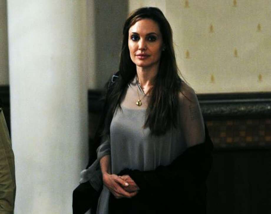 "Angelina Jolie ""I have hardly the words that somebody would do that to somebody's religious book,"" she  told the AP. Photo: FAROOQ NAEEM, AFP/Getty Images"