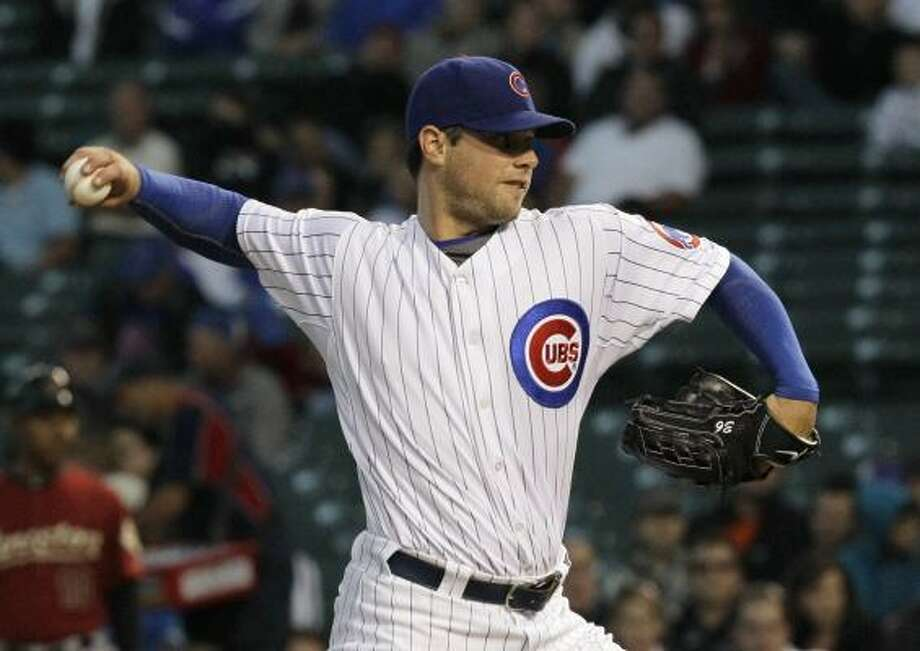 Cubs starter Randy Wells lasted six innings in his outing, allowing four runs. Photo: Charles Rex Arbogast, AP