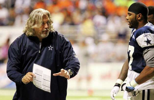 Defensive coordinator Rob Ryan (left) works with linebacker Victor Butler during the afternoon session of the Dallas Cowboys training camp at the Alamodome on Wednesday, Aug. 3, 2011. Kin Man Hui/kmhui@express-news.net Photo: KIN MAN HUI, : / SAN ANTONIO EXPRESS-NEWS