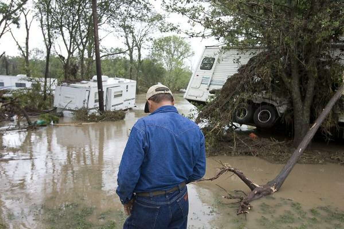 Richard Herndon locates his trailer in the background in the Shady River RV Resort on State Highway 29 east of Georgetown, Texas. Several people staying at the park lost everything when the waters crested and caused massive flooding.