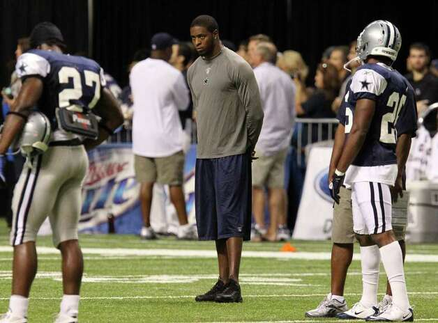 Cornerback Alan Ball watches the team practice during the afternoon session of the Dallas Cowboys training camp at the Alamodome on Wednesday, Aug. 3, 2011. Kin Man Hui/kmhui@express-news.net Photo: KIN MAN HUI, : / SAN ANTONIO EXPRESS-NEWS