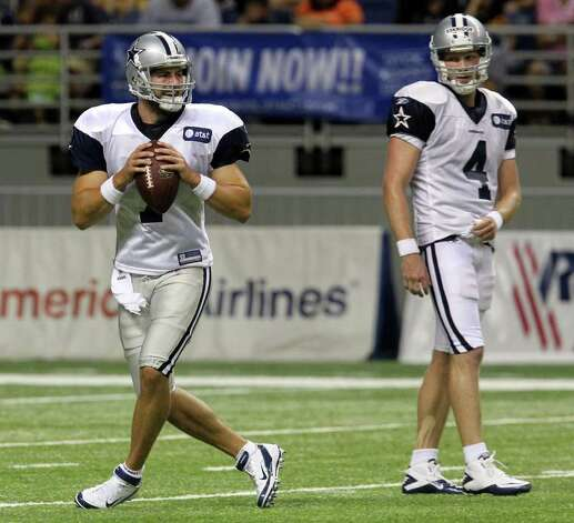 Quarterback Stephen McGee (left) steps back for a throw as fellow quarterback Zack Eskridge (04) looks on during the afternoon session of the Dallas Cowboys training camp at the Alamodome on Wednesday, Aug. 3, 2011. Kin Man Hui/kmhui@express-news.net Photo: KIN MAN HUI, : / SAN ANTONIO EXPRESS-NEWS