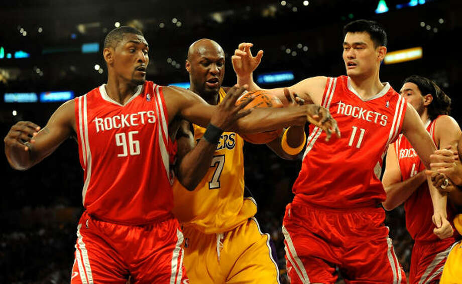 Yao Ming, right, will become an unrestricted free agent next summer if he doesn't sign an extension with the Rockets. Photo: Harry How, Getty Images