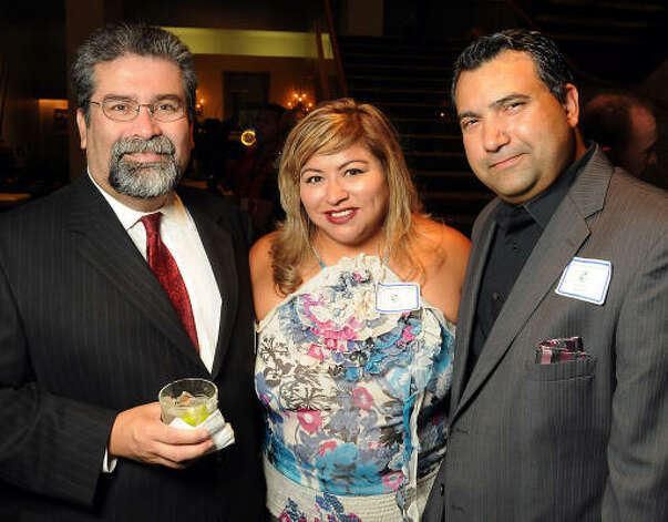 From left: Rene Martinez, Lisa Valentin and Saul Valentin Photo: Dave Rossman, For The Chronicle