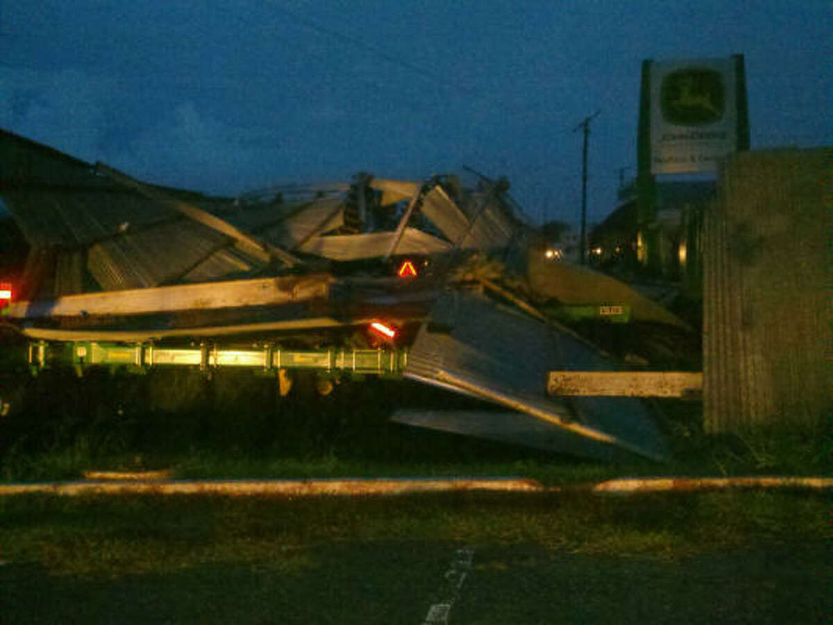 A mangled mess is all that remains of a John Deer dealership in Raymondville. Twitpic photo from farrahfazal, a KRGV reporter in Raymondville.