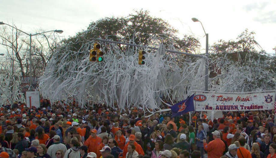 9. AUBURNTailgating is not just for pregame at Auburn. Visit Toomer's Corner (above) after the Tigers win. It's where the campus and the city converge and students toilet paper the trees to celebrate victories. Photo: Auburn University