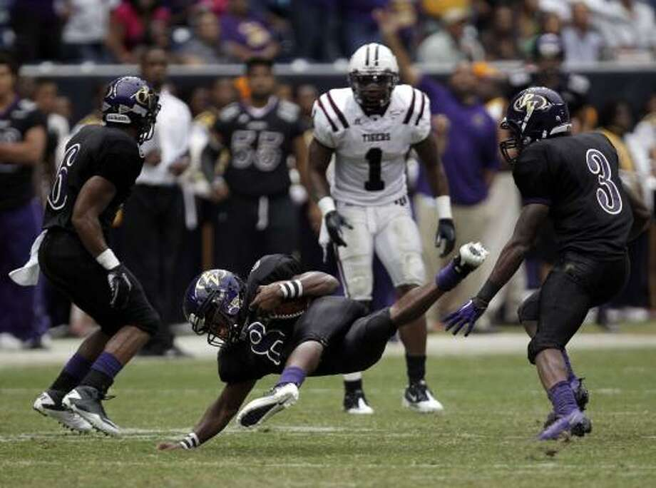 Sept. 5: Prairie View A&M 16, Texas Southern 14 Prairie View A&M's Lester Butler falls down while catching an interception in the second quarter of Sunday's game against Texas Southern at Reliant Stadium. Photo: Johnny Hanson, Chronicle