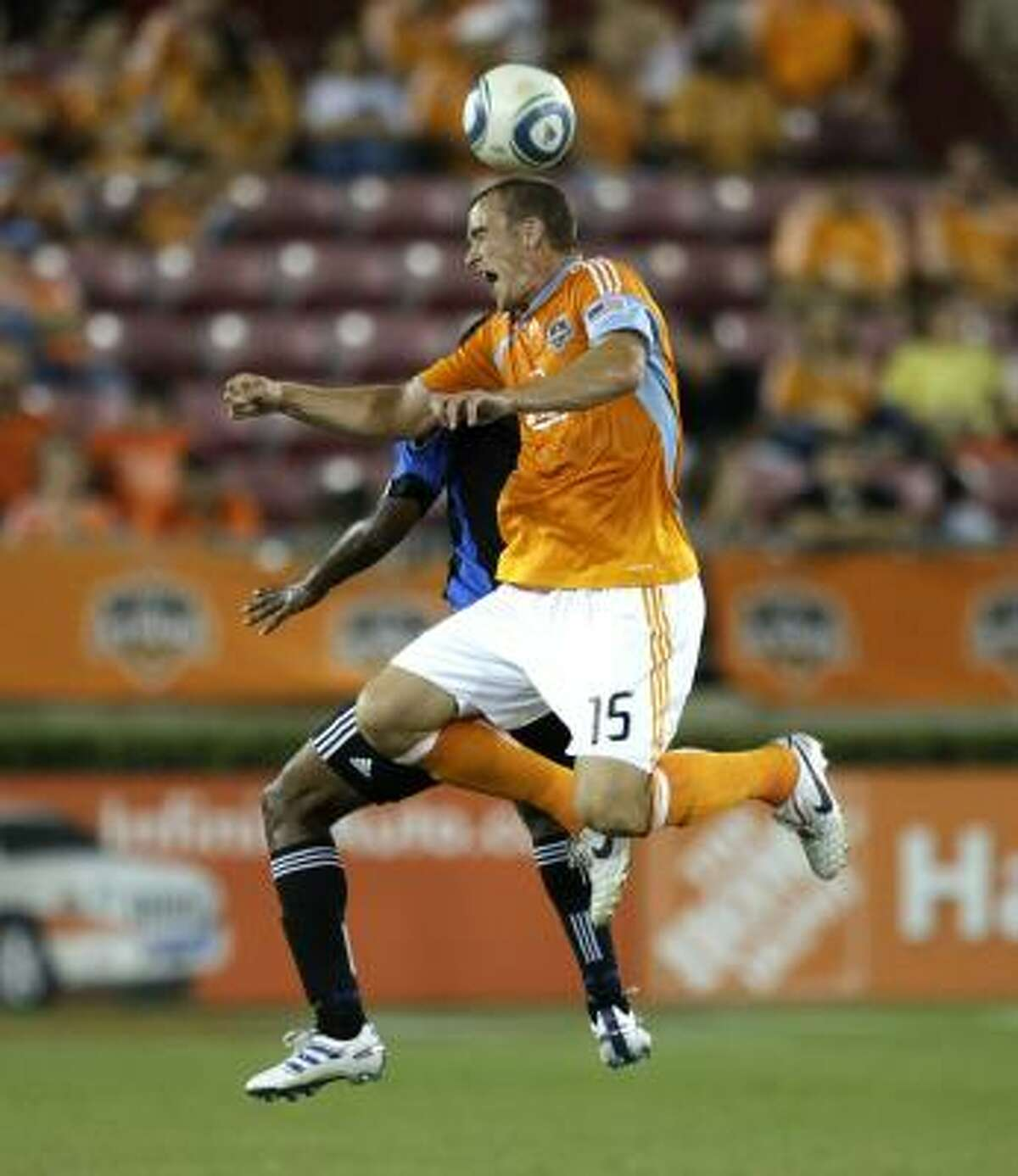 Cam Weaver goes up for a header against an Earthquakes player.