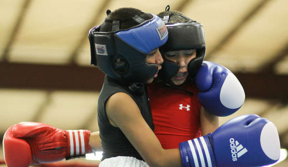 Rafael Arredondo, left, and Javier Lopez hug after final bell during the Houston Open Ring Nationals bantam weight novice championship. Photo: Nick De La Torre, Chronicle