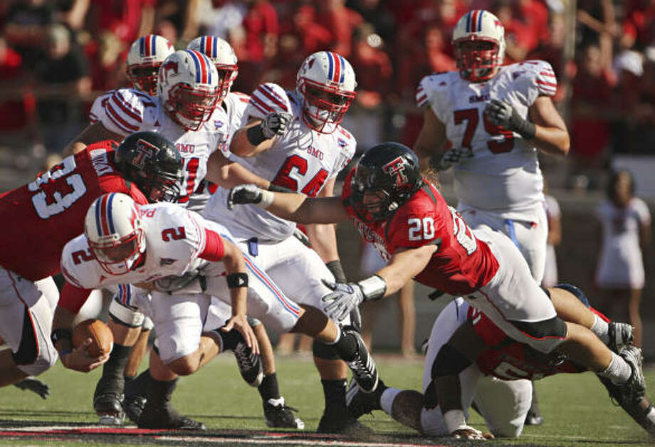 Sept. 5: Texas Tech 35, SMU 27Texas Tech linebacker Bront Bird (20) dives as he helps bring down Southern Methodist quarterback Kyle Padron during the second half. Photo: G.J. McCARTHY/Staff Photographer