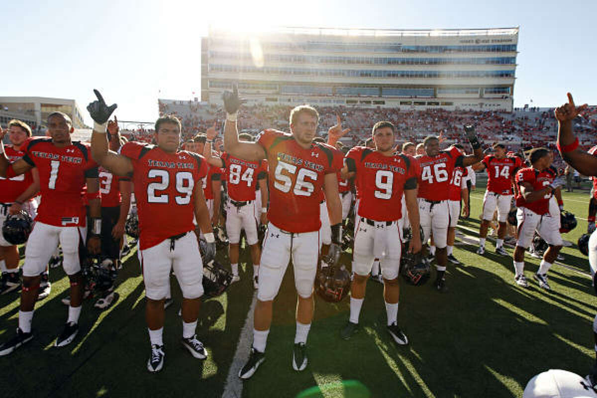 Texas Tech players celebrate their 35-27 win over Southern Methodist.