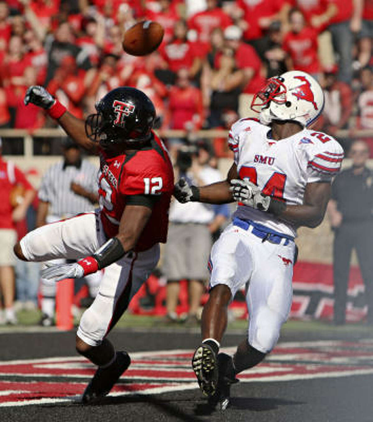 Texas Tech cornerback D.J. Johnson (left) breaks up a pass meant for Southern Methodist wide receiver Aldrick Robinson.