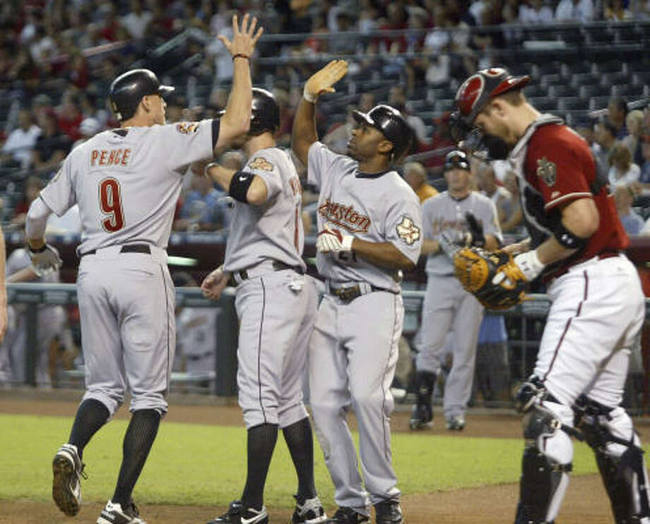 Sept. 5: Astros 3, Diamondbacks 2  Astros right fielder Hunter Pence, left, is congratulated by teammates Jeff Keppinger, second from left, and Michael Bourn following his three-run home run off Diamondbacks pitcher Rodrigo Lopez. Photo: Ralph Freso, AP