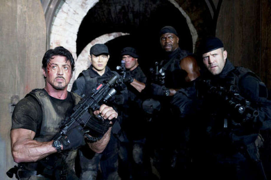 The Expendables, $6.8 million: A band of mercenaries goes to South America to deal with a thieving businessman. Starring, from left, Sylvester Stallone, Jet Li, Randy Couture, Terry Crews and Jason Statham. Photo: Lionsgate Films