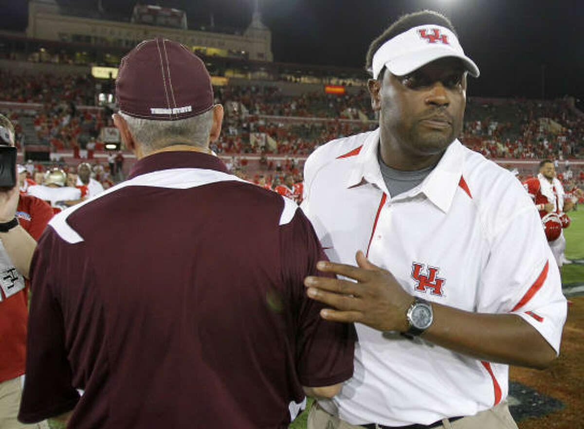 Texas State head coach Brad Wright congratulates Houston head coach Kevin Sumlin after the game.